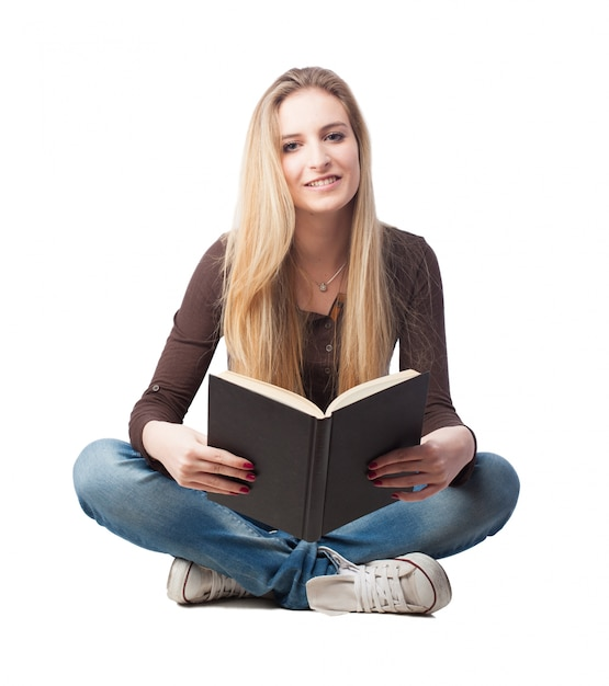 Smiling student reading a book Free Photo