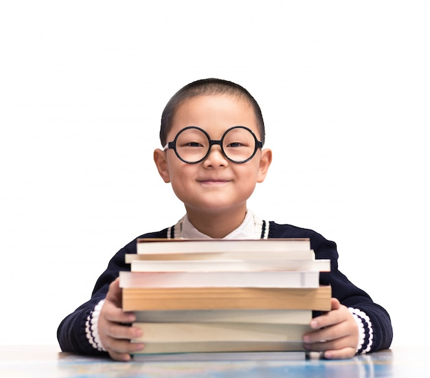 Smiling student sitting with his books Free Photo