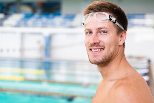 Smiling swimmer at the pool Free Photo