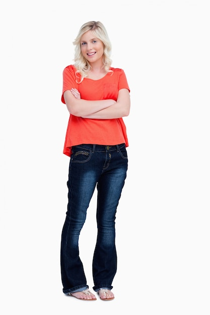 Smiling Teenager Crossing Her Arms While Standing Upright
