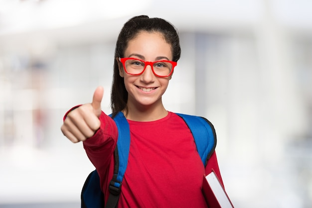 Smiling teenager student holding a book Premium Photo