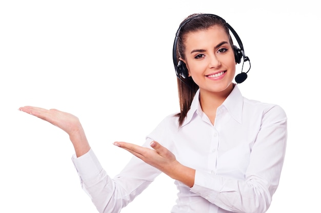 Smiling woman in headset presentation something Free Photo