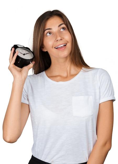 Smiling woman holding alarm watch Premium Photo