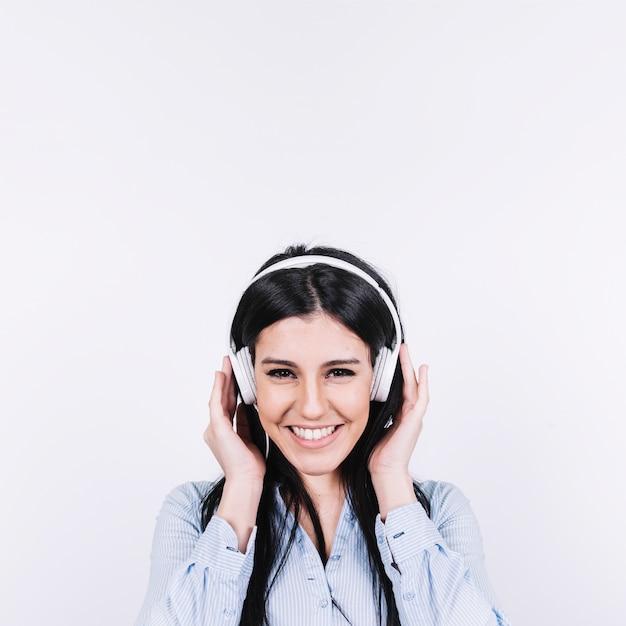Smiling woman in headphones 23 2147799106