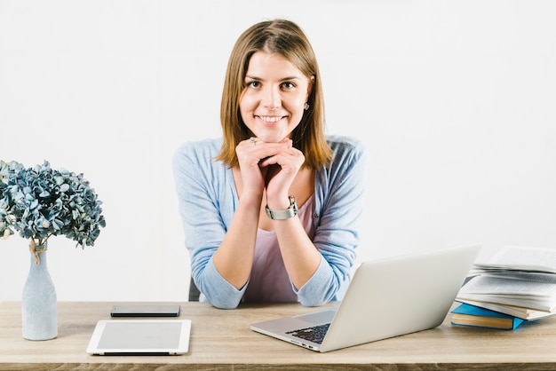 Smiling woman in office Free Photo