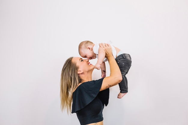 Smiling woman playing with baby Free Photo