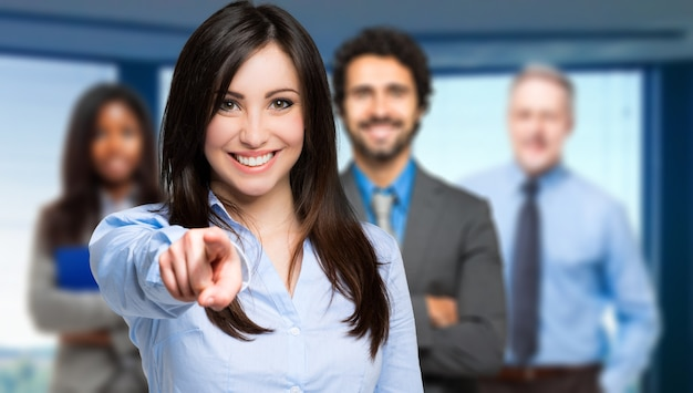 Smiling woman pointing her finger to you Premium Photo