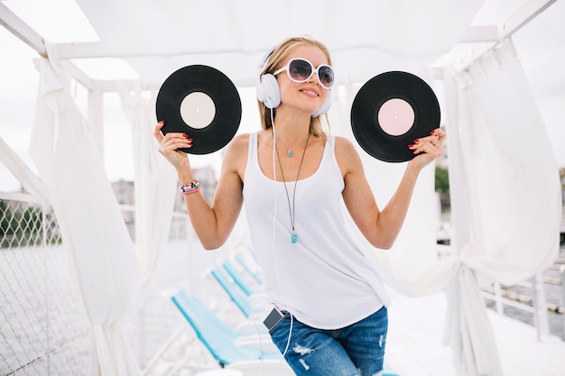 Smiling woman posing with vinyls 23 2147670572