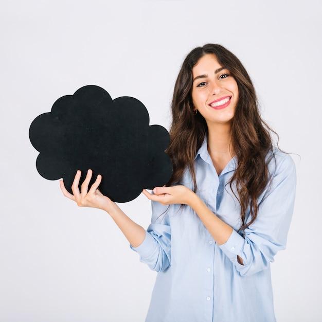 Smiling woman presenting speech bubble slate Free Photo