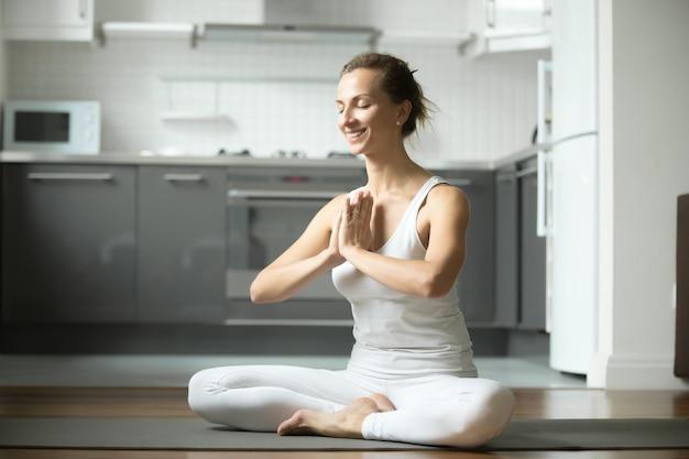 Smiling woman sitting in half lotus exercise Free Photo