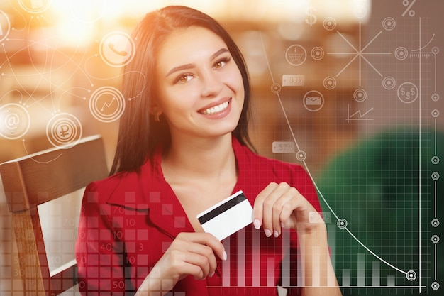 Smiling woman with a credit card Free Photo