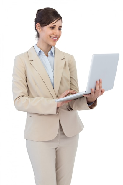 Smiling young businesswoman with laptop Premium Photo