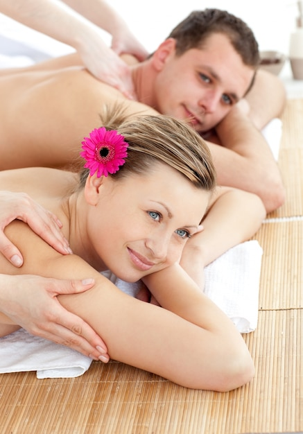 Smiling young couple receiving a back massage Premium Photo