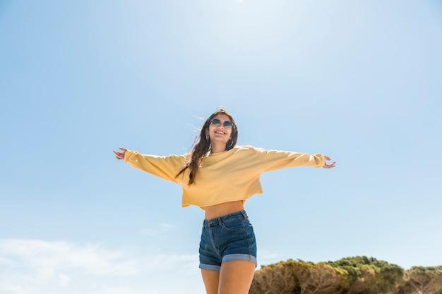 Smiling young female enjoying vacation Free Photo