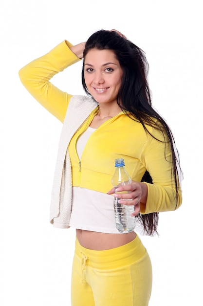 Smiling young girl doing fitness exercise Free Photo