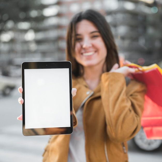 Smiling young lady with tablet Free Photo