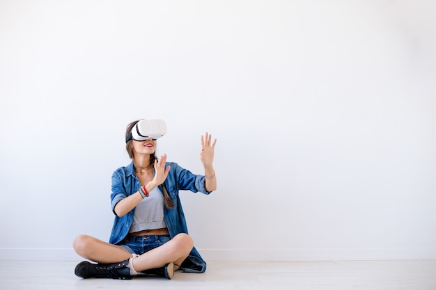 Smiling young woman use vr glasses Free Photo