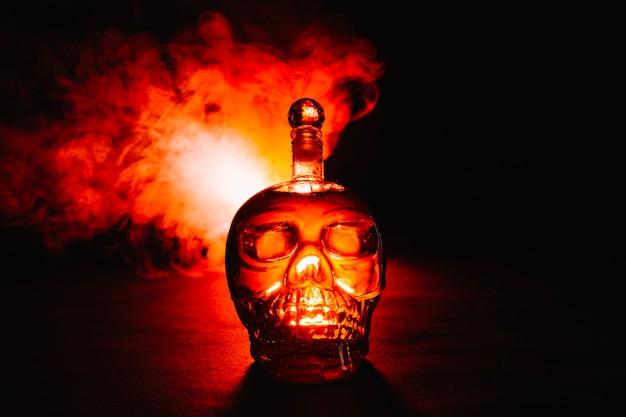 Smoke and bottle of poison Free Photo