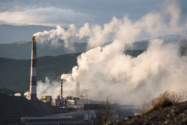 Smoke from smoke stack representing pollution Premium Photo