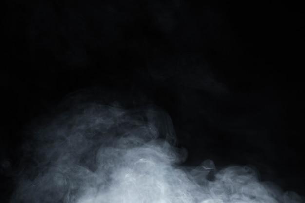 Дым на черном фоне Premium Фотографии