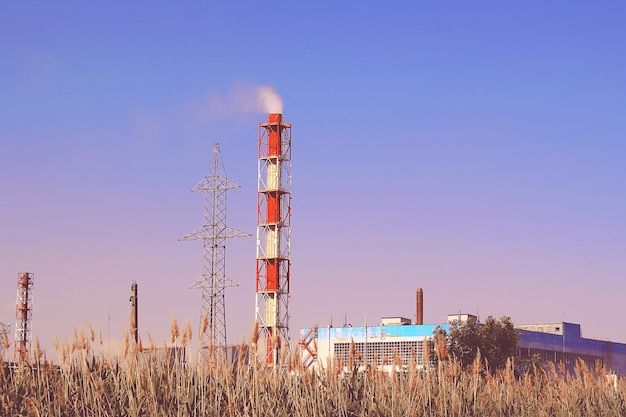 Smoke industrial chimney. pipes pollutes atmosphere city. environment, emissions water resources. Premium Photo