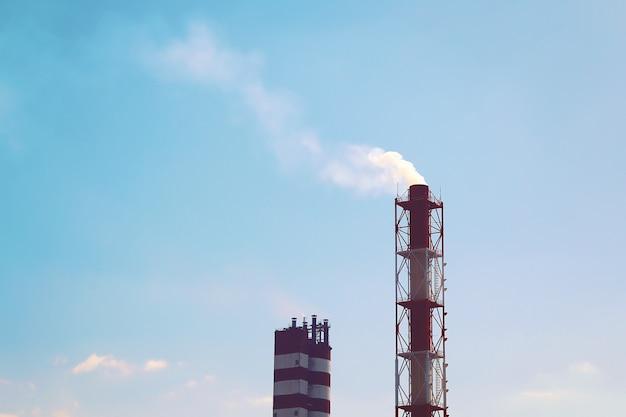 Smoke industrial chimney. Premium Photo