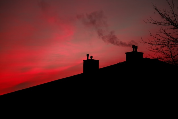 Smoke sunrise sky morning smoke from the flue house Premium Photo