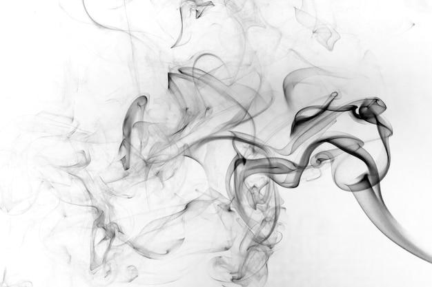 Smoke toxic movement on a white background. Premium Photo
