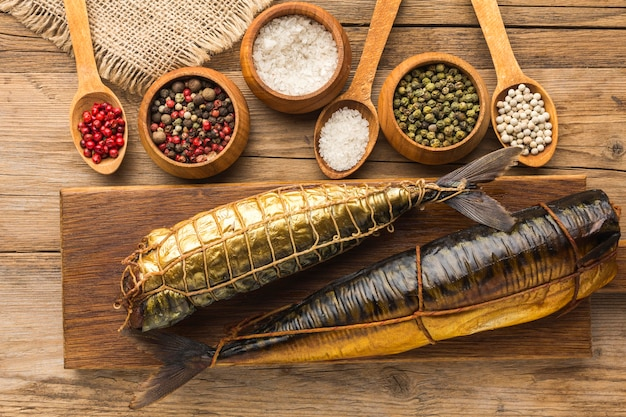 Smoked fishes and spices arrangement Free Photo