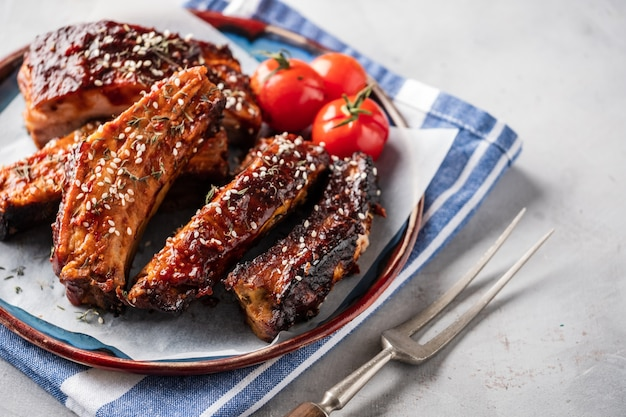 Smoked roasted pork ribs on the plate. delicious grilled bbq ribs Premium Photo