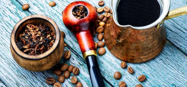 Smoking pipe and coffee Premium Photo