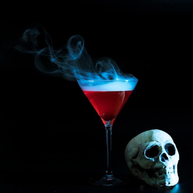 Smoky goblet and skull Free Photo