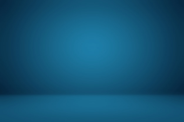 smooth dark blue with black vignette studio well use as background