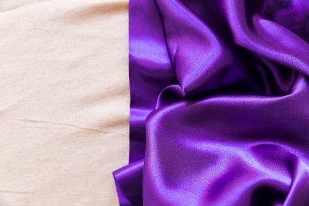 Smooth purple fabric on plain textile Free Photo
