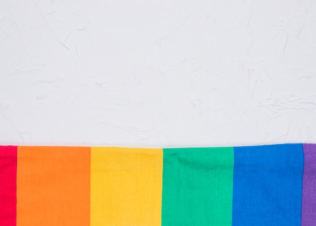 Smoothed lgbt flag on white surface Free Photo