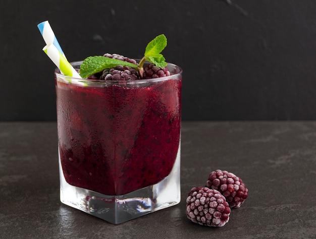 Smoothie of blackberries and currants. on dark background. Premium Photo