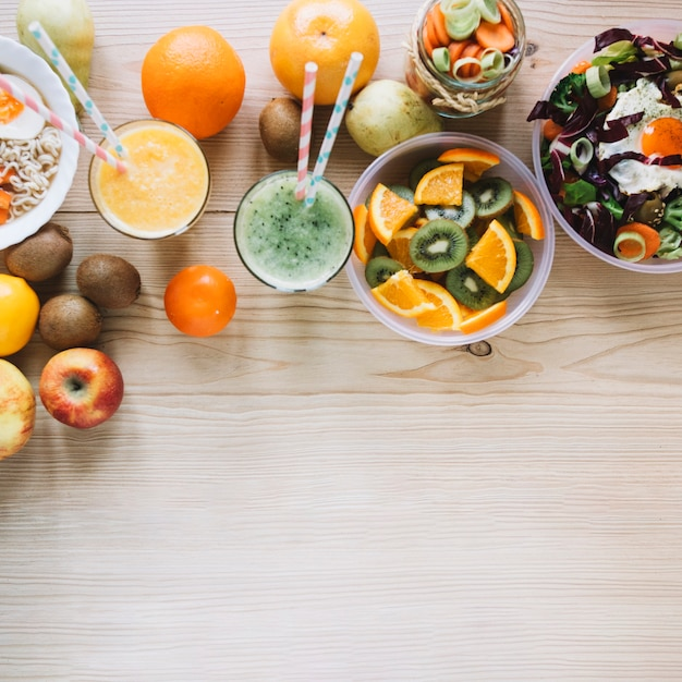 Smoothie and fruits near healthy dishes Free Photo