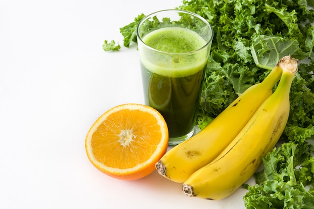 Smoothie with kale,banana and orange isolated on white copy space Premium Photo