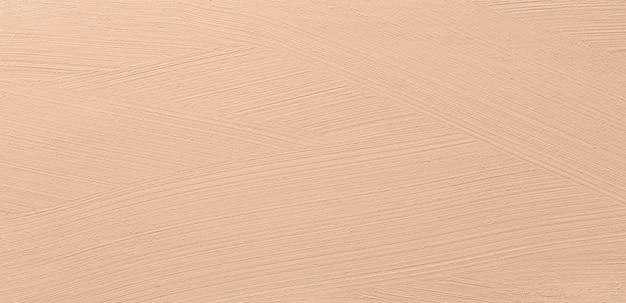 Smudged make up  foundation texture background Premium Photo