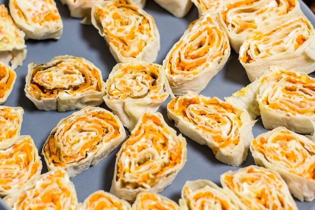 Snack roll of pita bread  korean carrots on plate Premium Photo