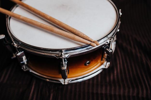 Snare drum on the dark background Premium Photo