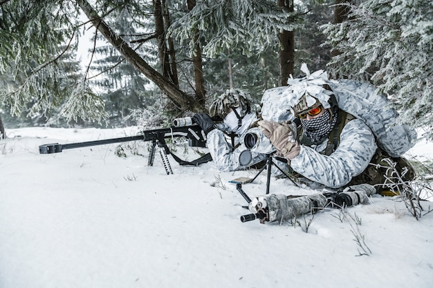 Sniper and spotter somewhere above the arctic circle Premium Photo