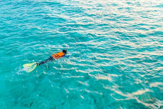 Snorkeling in tropical maldives island . Premium Photo