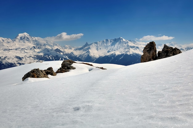 Snow on mountain in winter under blue sky Premium Photo