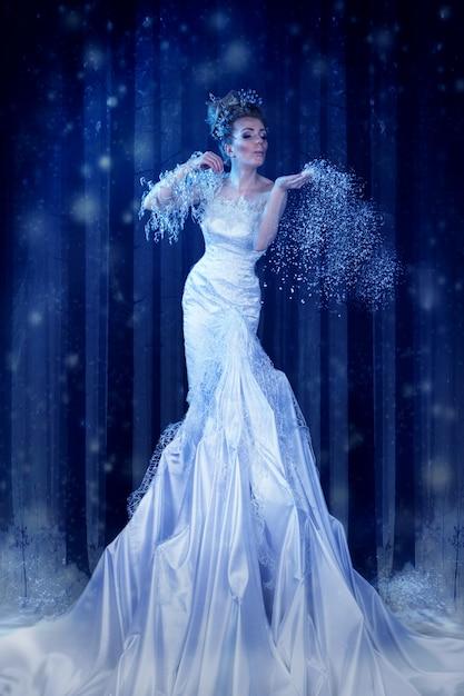 Snow queen in the forest creates a blizzard Premium Photo