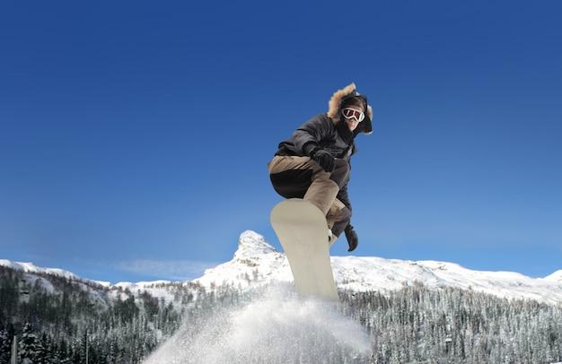 Snowboarding in the mountains Premium Photo
