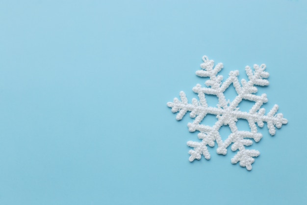 Snowflake on blue surface Free Photo