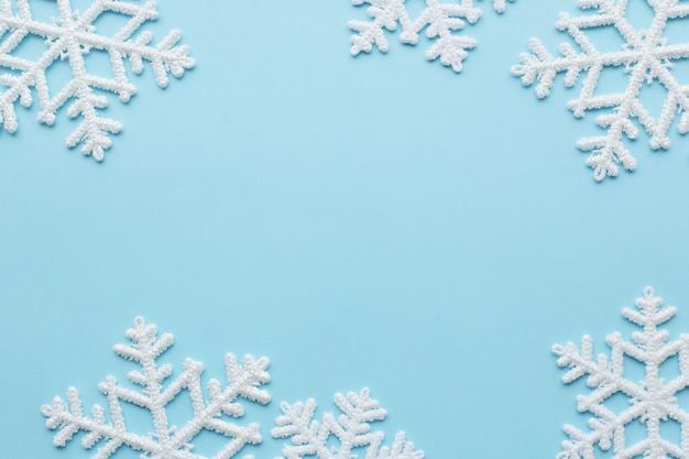 Snowflakes on blue surface Free Photo