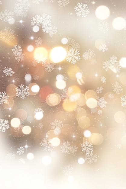Sfondo dorato di natale con i fiocchi di neve e stelle Foto Gratuite