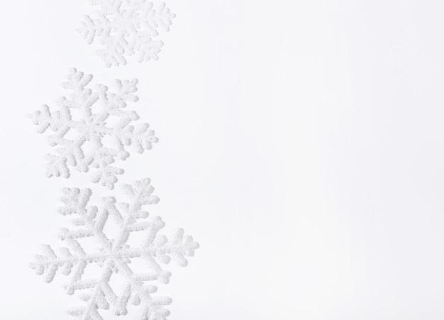 Snowflakes on white surface Free Photo